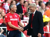 Arsenal boss Arsene Wenger shakes hands with Crystal Palace's caretaker manager Keith Millen on August 16, 2014