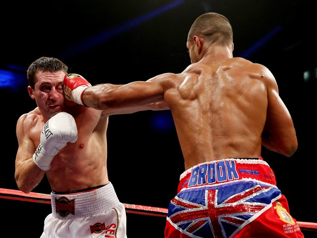 Kell Brook catches Vyacheslav Senchenko with a straight left during their Final Eliminator for the IBF World Welterweight Championship bout at Motorpoint Arena on October 26, 2013