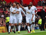 Ki Sung-Yeung is congratulated by his Swansea teammates after scoring the opener against Man United on August 16, 2014