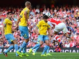 Laurent Koscielny scores the equaliser for Arsenal against Crystal Palace on August 16, 2014