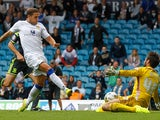 Billy Sharp of Leeds scores his sides first goal during the Sky Bet Championship match between Leeds United and Middlesbrough at Elland Road on August 16, 2014
