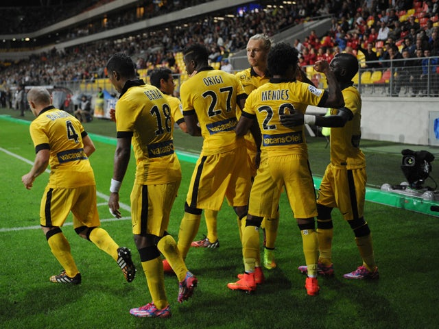 Lille's Belgian Forward Divock Origi celebrates with teammates after scoring a penalty during the French L1 football match between Caen (SM Caen) and Lille (LOSC) on August 15, 2014