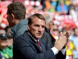 Liverpool's Northern Irish manager Brendan Rodgers applauds before the start of the English Premier League football match between Liverpool and Southampton at Anfield stadium in Liverpool, northwest England, on August 17, 2014