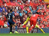 Liverpool's English striker Daniel Sturridge scores his team's second goal past Southampton's English goalkeeper Fraser Forster during the English Premier League football match between Liverpool and Southampton at Anfield stadium in Liverpool, northwest E