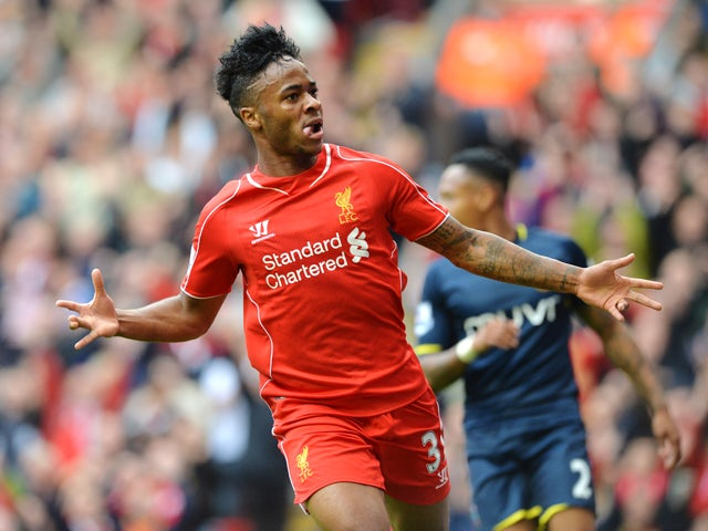 Liverpool's English midfielder Raheem Sterling celebrates scoring the opening goal during the English Premier League football match between Liverpool and Southampton at Anfield stadium in Liverpool, northwest England, on August 17, 2014