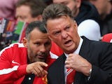 Louis van Gaal and Ryan Giggs discuss tactics during Man United's Premier League opener with Swansea on August 16, 2014