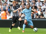 Newcastle United's English midfielder Jack Colback vies with Manchester City's Serbian defender Aleksandar Kolarov during the English Premier League football match between Newcastle United and Manchester City at St James' Park in Newcastle-upon-Tyne, nort