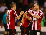 Marc McNulty of Sheffield United celebrates scoring his teams winning goal with team mate Ben Davies during the Capital One Cup First Round match between Sheffield United and Mansfield Town at Bramell Lane on August 13, 2014