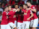 Marouane Fellaini of Manchester United is congratulated by team mates after scoring the winning goal in the last minute during the Pre Season Friendly match against Valencia on August 12, 2014
