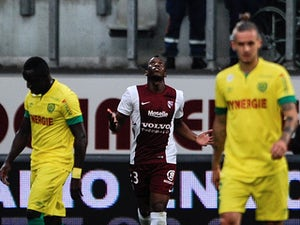 Metz strike twice to steal victory