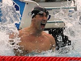 Michael Phelps of the United States celebrates victory in the Men's 100m Butterfly Final held at the National Aquatics Centre during Day 8 of the Beijing 2008 Olympic Games on August 16, 2008