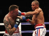 Mikkel Kessler of Denmark (L) is hit by Andre Ward during their WBA Super Middleweight Championship Bout at the Oakland-Alameda County Coliseum on November 21, 2009