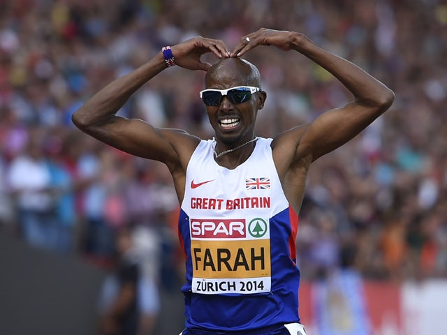 Great Britain's Mohamed Farah celebrates after winning the Men's 5000m final during the European Athletics Championships at the Letzigrund stadium in Zurich on August 17, 2014