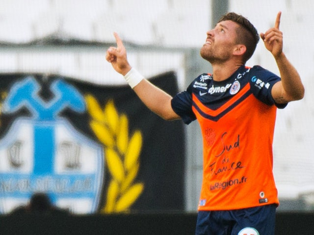 Montpellier's French forward Anthony Mounier celebrates after scoring a goal during the French L1 football match between Olympique de Marseille (OM) and Montpellier (MHSC) on August 17, 2014