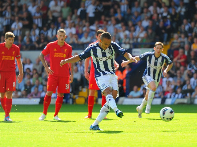 Peter Odemwingie of West Brom scores their second goal from the penalty spot during the Barclays Premier League match between West Bromwich Albion and Liverpool at The Hawthorns on August 18, 2012