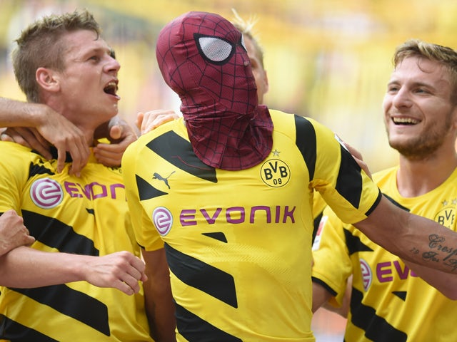 Dortmund's Gabonese striker Pierre-Emerick Aubameyang celebrates scoring the 2-0 goal during the German Supercup football match Borussia Dortmund vs Bayern Munich in the German city of Dortmund on August 13, 2014