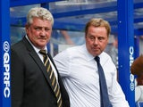 Steve Bruce the Hull City manager and Harry Redknapp the QPR manager look on Barclays Premier League match between Queens Park Rangers and Hull City at Loftus Road on August 16, 2014