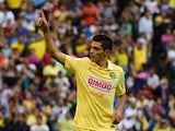 Raul Jimenez of America celebrates a goal against Atletico de Madrid during their EuroAmerican Cup football match at the Azteca Stadium, in Mexico City, on July 30 2014