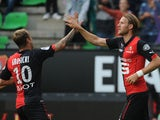 Rennes' Swedish forward Ola Toivonen celebrates with his teammate Rennes' Polish forward Kamil Grosicki after scoring a goal during the French L1 football match between Stade Rennais FC and Evian-Thonon Gaillard FC on August 16, 2014