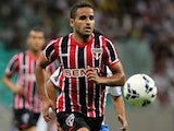 Douglas of Sao Paulo battles for the ball during the match between Bahia and Sao Paulo as part of Brasileirao Series A 2014 at Arena Fonte Nova on July 16, 2014