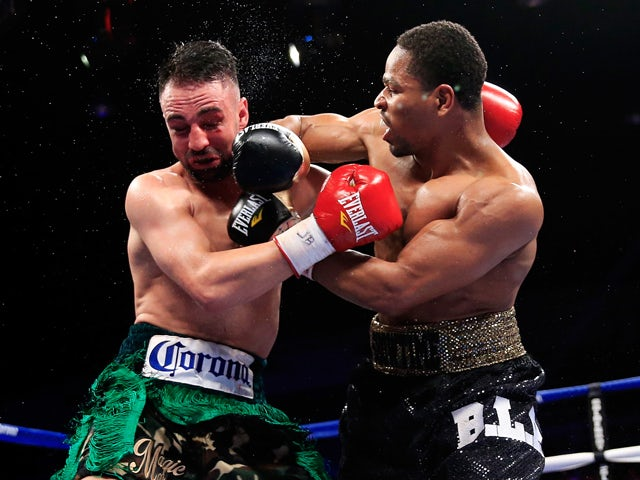 Shawn Porter lands a punch on Paulie Malignaggi during their IFB Welterweight Title fight on April 19, 2014