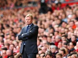 Ronald Koeman, manager of Southampton looks on during the Barclays Premier League match between Liverpool and Southampton at Anfield on August 17, 2014