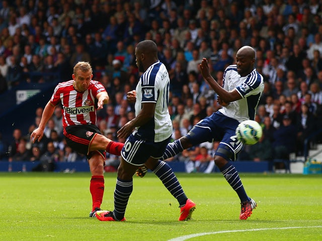 Lee Cattermole of Sunderland scores the opening goal during the Barclays Premier League match between West Bromwich Albion and Sunderland at The Hawthorns on August 16, 2014