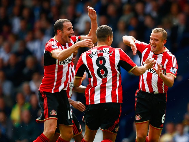 Lee Cattermole of Sunderland celebrates scoring the opening goal with John O'Shea and Jack Rodwell of Sunderland during the Barclays Premier League match between West Bromwich Albion and Sunderland at The Hawthorns on August 16, 2014