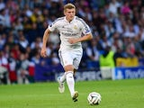 Real Madrids German midfielder Toni Kroos runs with the ball during the UEFA Super Cup football match between Real Madrid and Sevilla at Cardiff City Stadium in Cardiff, south Wales on August 12, 2014