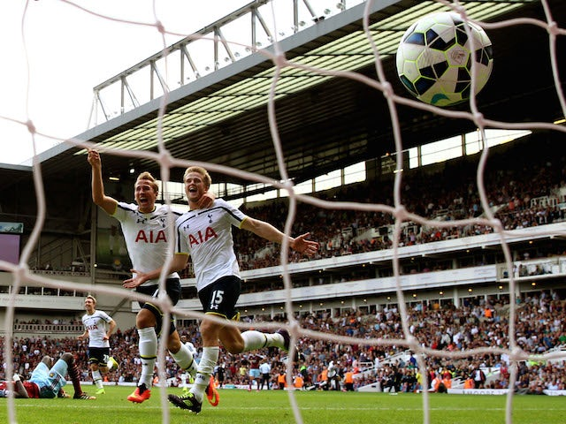 Harry Kane and Eric Dier celebrate the latter's winning goal for Tottenham Hotspur against West Ham United in the Premier League on August 16, 2014