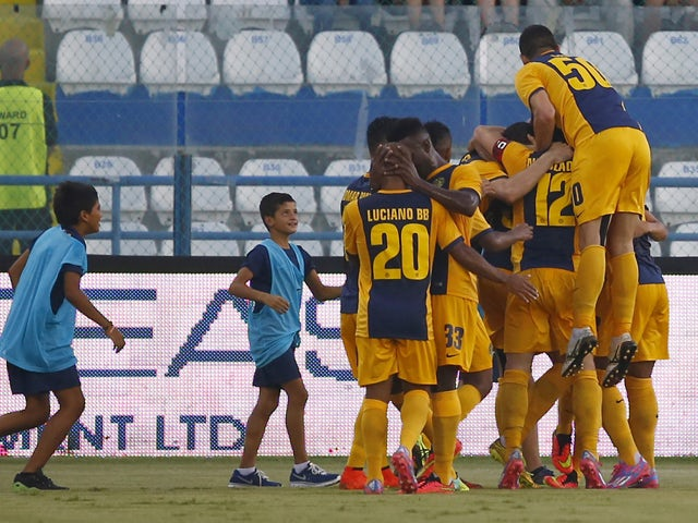Players from AEL Limassol FC celebrate a goal during the AEL Limassol FC v Tottenham Hotspur - UEFA Europa League Qualifying Play-Off match on August 21, 2014