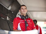 Reserve driver Alexander Rossi of the United States and Marussia looks on from the pit wall during practice ahead of the Hungarian Formula One Grand Prix at Hungaroring on July 25, 2014