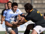 Argentina's Los Pumas' wing Lucas Gonzalez Amorosino runs through a tackle by South Africa's Springboks' hooker Bismarck du Plessis during the Rugby Championship second round match at Padre Ernesto Martearena stadium in Salta, some 1580 km northwest of Bu