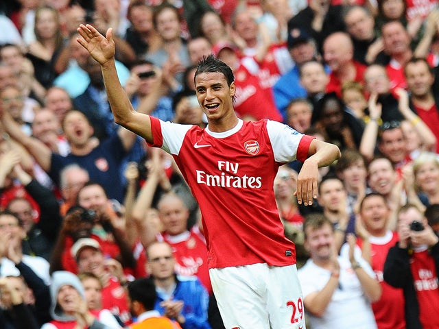 Arsenal's French striker Marouane Chamakh celebrates after he scores the sixth goal of the English Premier League football match between Arsenal and Blackpool at the Emirates Stadium in London, England on August 21, 2010