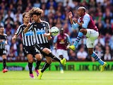 Fabian Delph of Aston Villa challenges Fabricio Coloccini of Newcastle United during the Barclays Premier League match between Aston Villa and Newcastle United at Villa Park on August 23, 2014