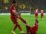 Leverkusen's Bosnian defender Emir Spahic and Leverkusen's striker Stefan Kiessling celebrate after the German first division Bundesliga football match Borussia Dortmund vs Bayer Leverkusen in Dortmund, western Germany on August 23, 2014