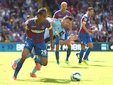Marouane Chamakh of Crystal Palace and Mauro Zarate of West Ham in action during the Premiere League match between Crystal Palace and West Ham United at Selhurst Park on August 23, 2014