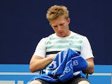 Daniel Cox of Great Britain takes a break during his Men's Singles first round match against James Ward of Great Britain on day one of the AEGON Championships at Queens Club on June 6, 2011
