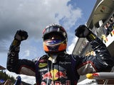 Red Bull Racing's Australian driver Daniel Ricciardo celebrates in the parc ferme at the Spa-Francorchamps circuit in Spa on August 24, 2014
