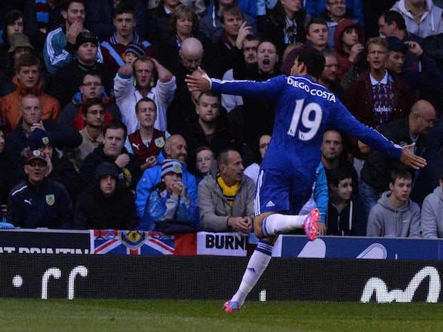 Chelsea striker Diego Costa celebrates scoring their first goal in front of the Burnley fans during the English Premier League football match on August 18, 2014