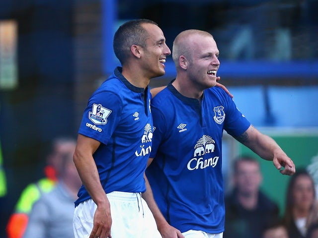 Steven Naismith of Everton celebrates scoring the second goal with team mate Leon Osman during the Barclays Premier League match between Everton and Arsenal at Goodison Park on August 23, 2014