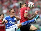 Schalke's defender Benedikt Howedes vies with Hanover's Spanish striker Joselu during the German first division Bundesliga football match Hannover 96 v FC Schalke 04, at HDI-Arena in Hanover, Germany on August 23, 2014