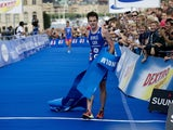 Britain's Jonathan Brownlee crosses the finish line to win the sixth round of the ITU World Triathlon Series, an Intermediate distance race (1,5 km swim, 40 km bike and 10 km run), in Stockholm on August 25, 2012