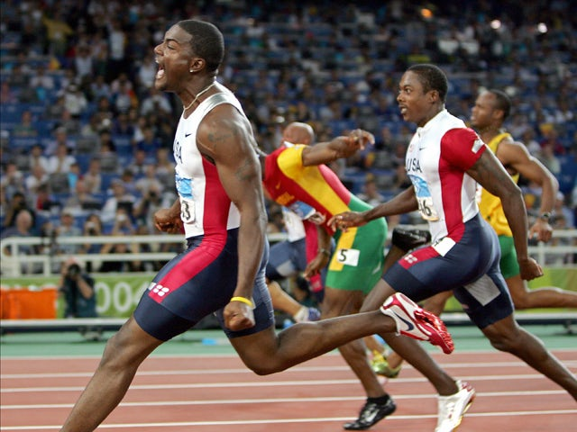 Justin Gatlin of the US wins the gold in the men's 100m final, 22 August 2004
