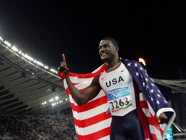 Justin Gatlin of the US gestures after he won gold in the men's 100m final, 22 August 2004