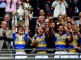 Captain Kevin Sinfield of Leeds lifts the Challenge Cup Trophy after his team won the Tetley's Challenge Cup Final between Leeds Rhinos and Castleford Tigers at Wembley Stadium on August 23, 2014