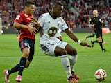 Lorient's French Ivorian defender Lamine Kone vies with Lille's Portuguese midfielder Marco Lopes during the French L1 football match Lille (LOSC) vs Lorient (FCL) on August 23, 2014