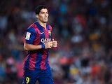 Luis Suarez of FC Barcelona looks on during the Joan Gamper Trophy match between FC Barcelona and Club Leon at Camp Nou on August 18, 2014