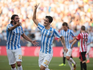 Malaga come from behind to beat Elche