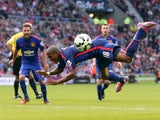 Manchester United's English midfielder Ashley Young falls to the ground after a challenge by Sunderland's English defender Wes Brown during the English Premier League football match between Sunderland and Manchester United at The Stadium of Light in Sunde